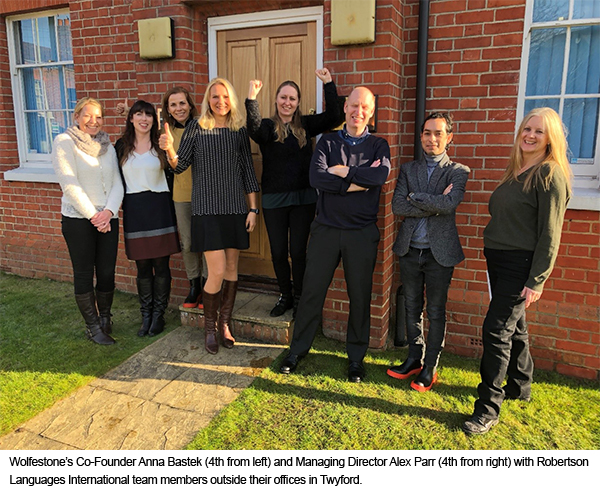 Wolfestone's Co-Founder Anna Bastek (4th from left) and Managing Director Alex Parr (4th from right) with Robertson Languages International team members outside their offices in Twyford.